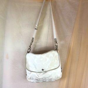 White fabric coach messenger bag